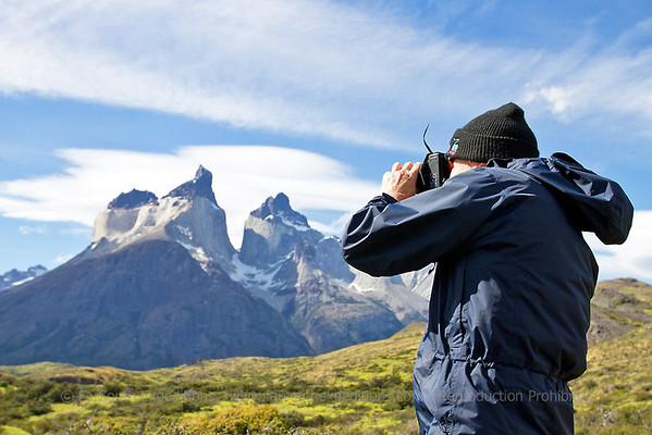 Guest photographing guanacos at Torres del Paine National Park, Chile © Claudio F. Vidal, Far South Expeditions
